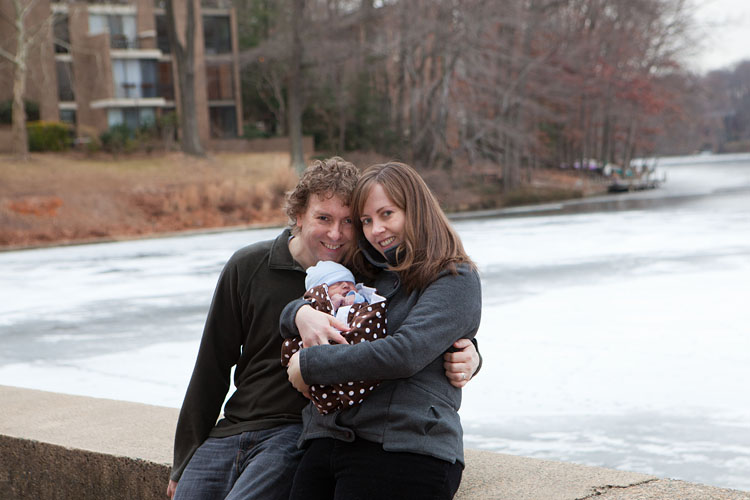 Family with newborn baby at Lake Anne in Reston
