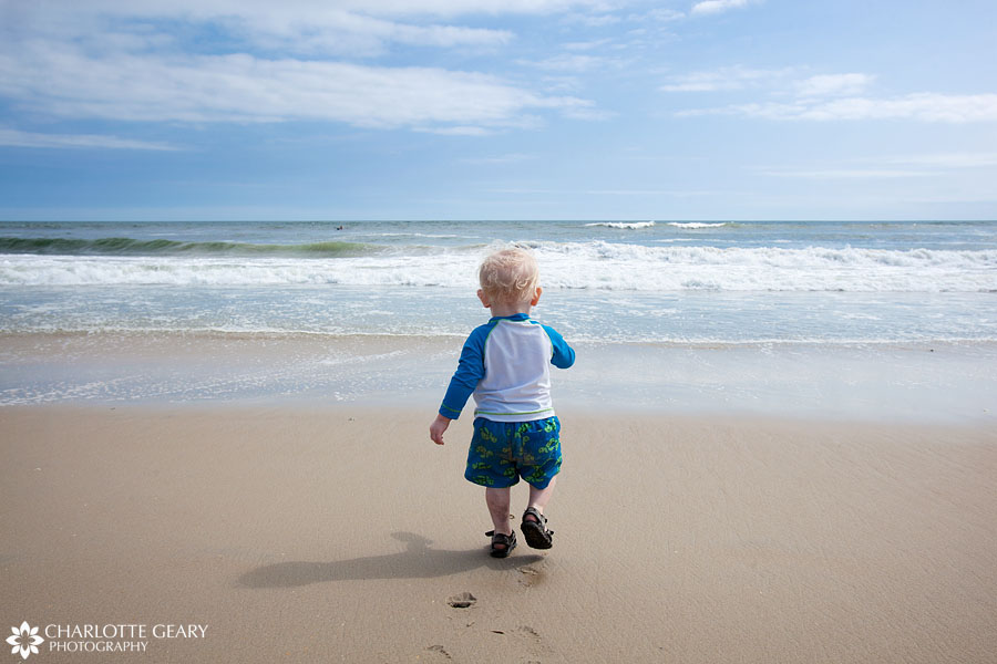 Toddler boy on the beach in Corolla, NC | Photo by Charlotte Geary