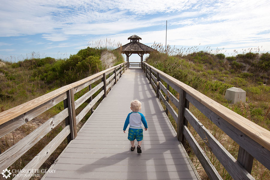 Toddler on the boardwalk in Corolla, NC | Photo by Charlotte Geary