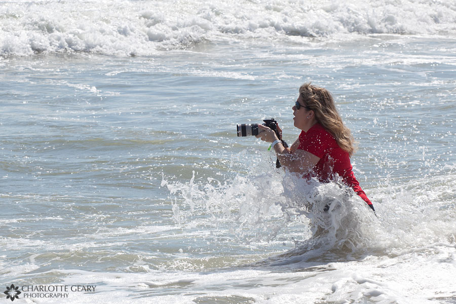Photographer splashed in the waves at the beach
