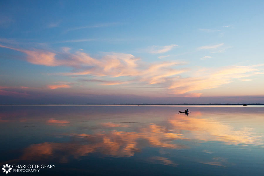 Paddleboarder at sunset in Corolla, NC   Photo by Charlotte Geary