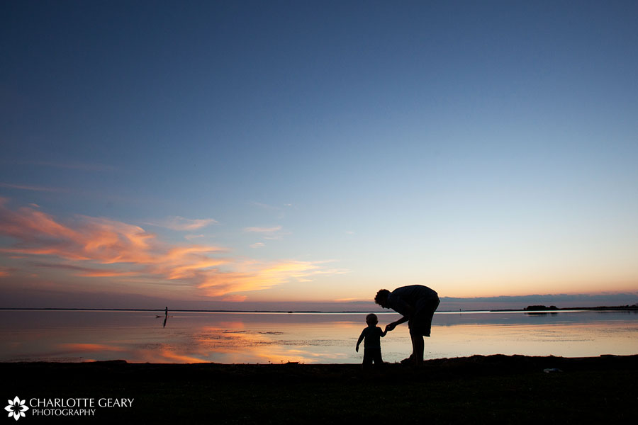 Father and toddler at sunset at the beach in Corolla, NC   Photo by Charlotte Geary