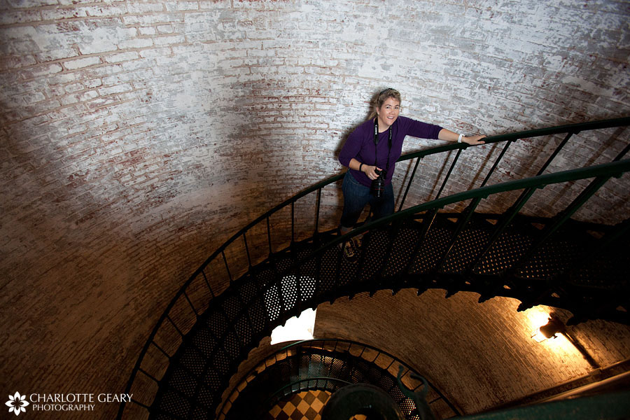 Woman in the Currituck Lighthouse staircase in Corolla, NC | Photo by Charlotte Geary