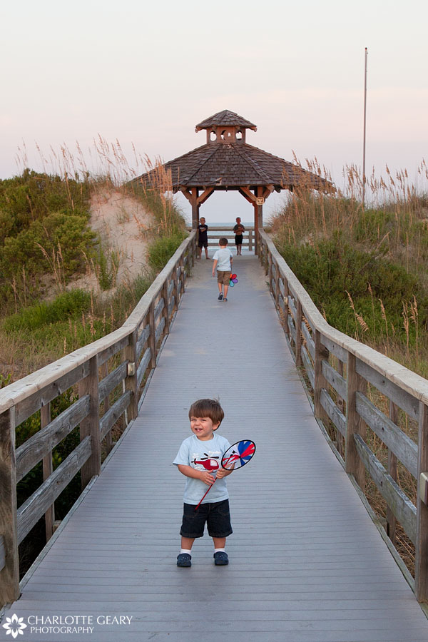 Toddler boy at the beach in Corolla, NC | Photo by Charlotte Geary