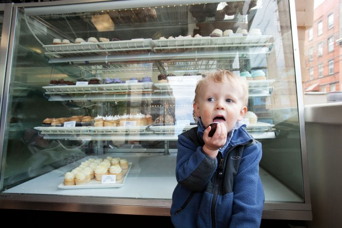 Day in the life photography of a boy at a bakery