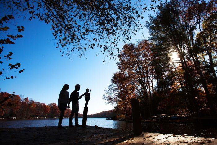 Silhouette family portrait at Lake Anne in Reston, Virginia