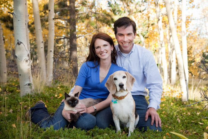Portrait of a veterinarian couple with their pets