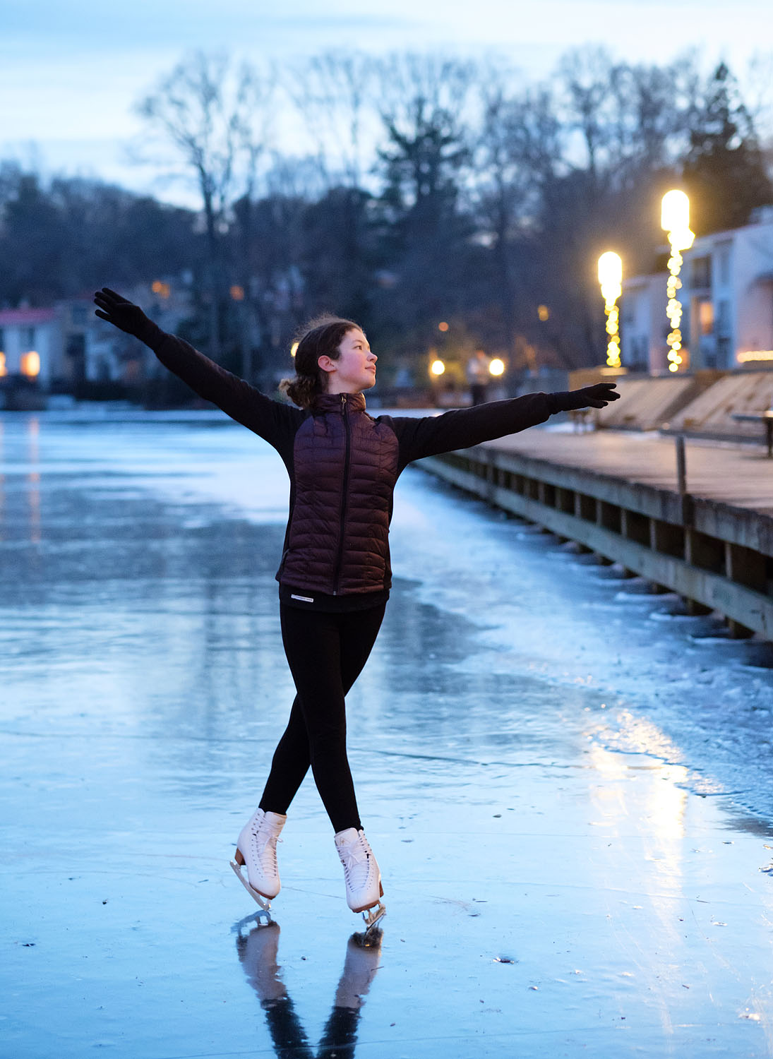 Ice skater on frozen Lake Anne in Reston, Virginia