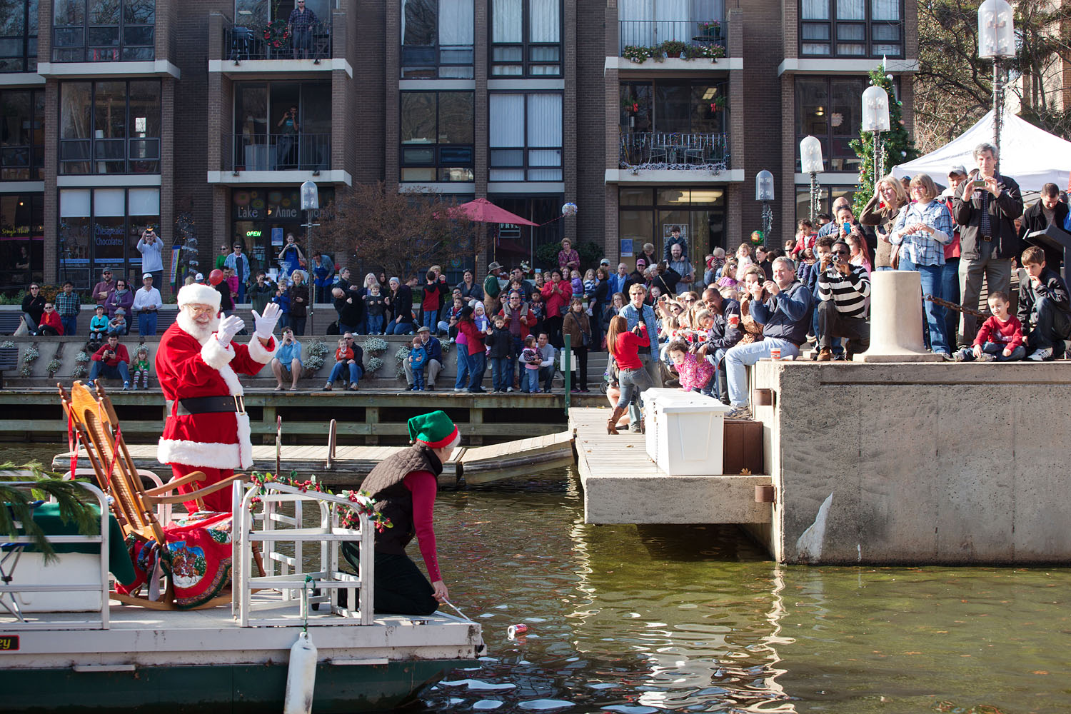 Santa arriving at Lake Anne by boat
