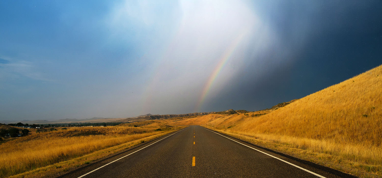 Rainbow over Wyoming highway