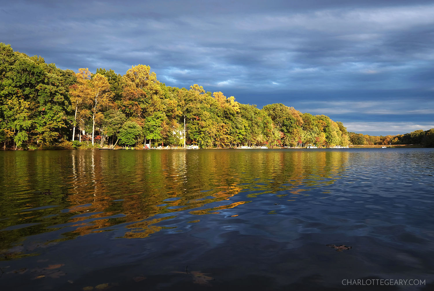Storm clouds and fall colors at Lake Anne in Reston