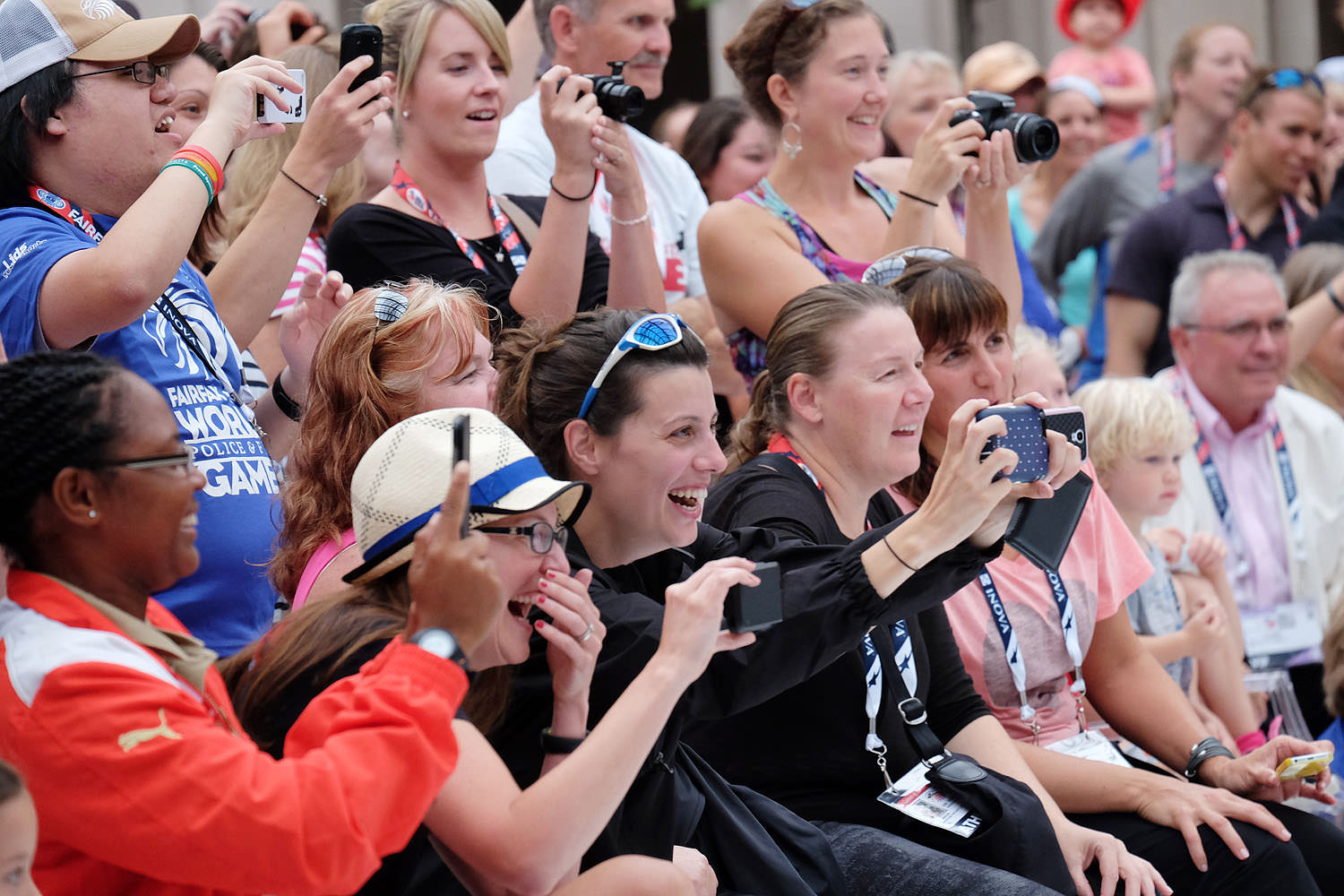 Donut eating contest spectators at the World Police and Fire Games Athlete's Village