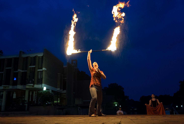 Fire twirler at Lake Anne Plaza