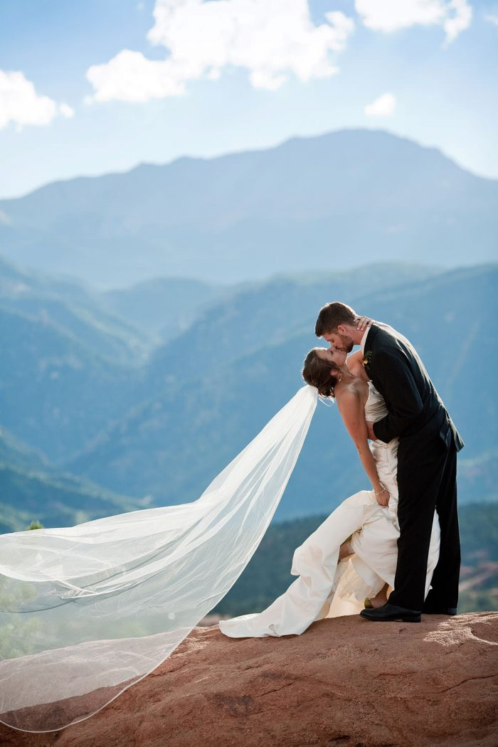 Bride and groom in front of Pikes Peak in the Garden of the Gods in Colorado Springs