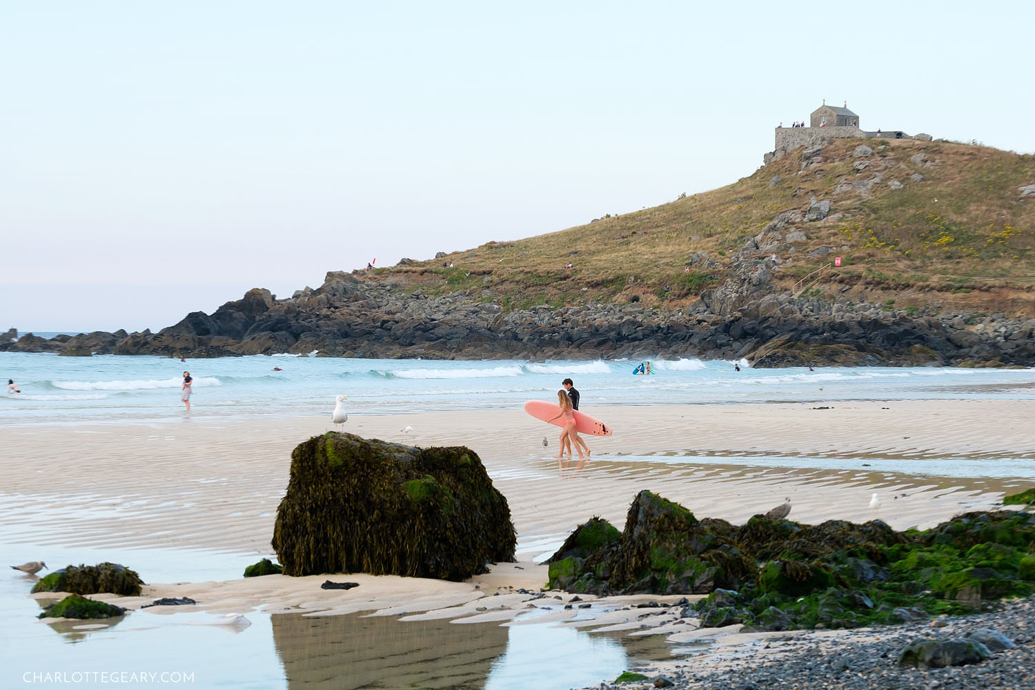 Surfers on Porthmeor Beach in St. Ives, Cornwall, England