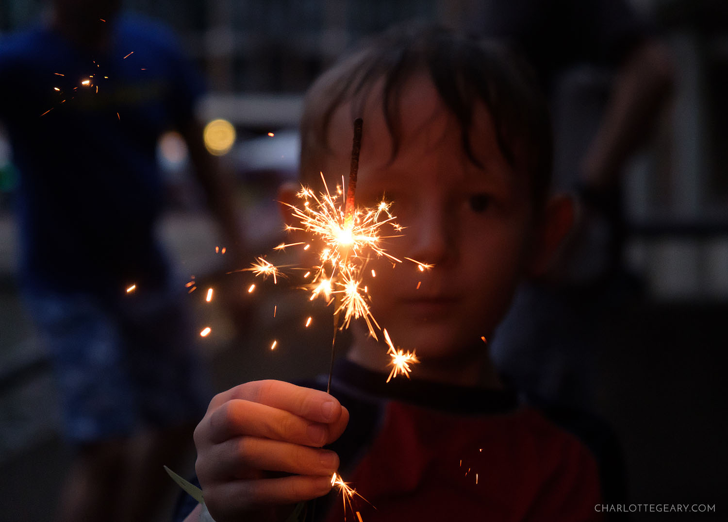 Child with sparkler on the 4th of July