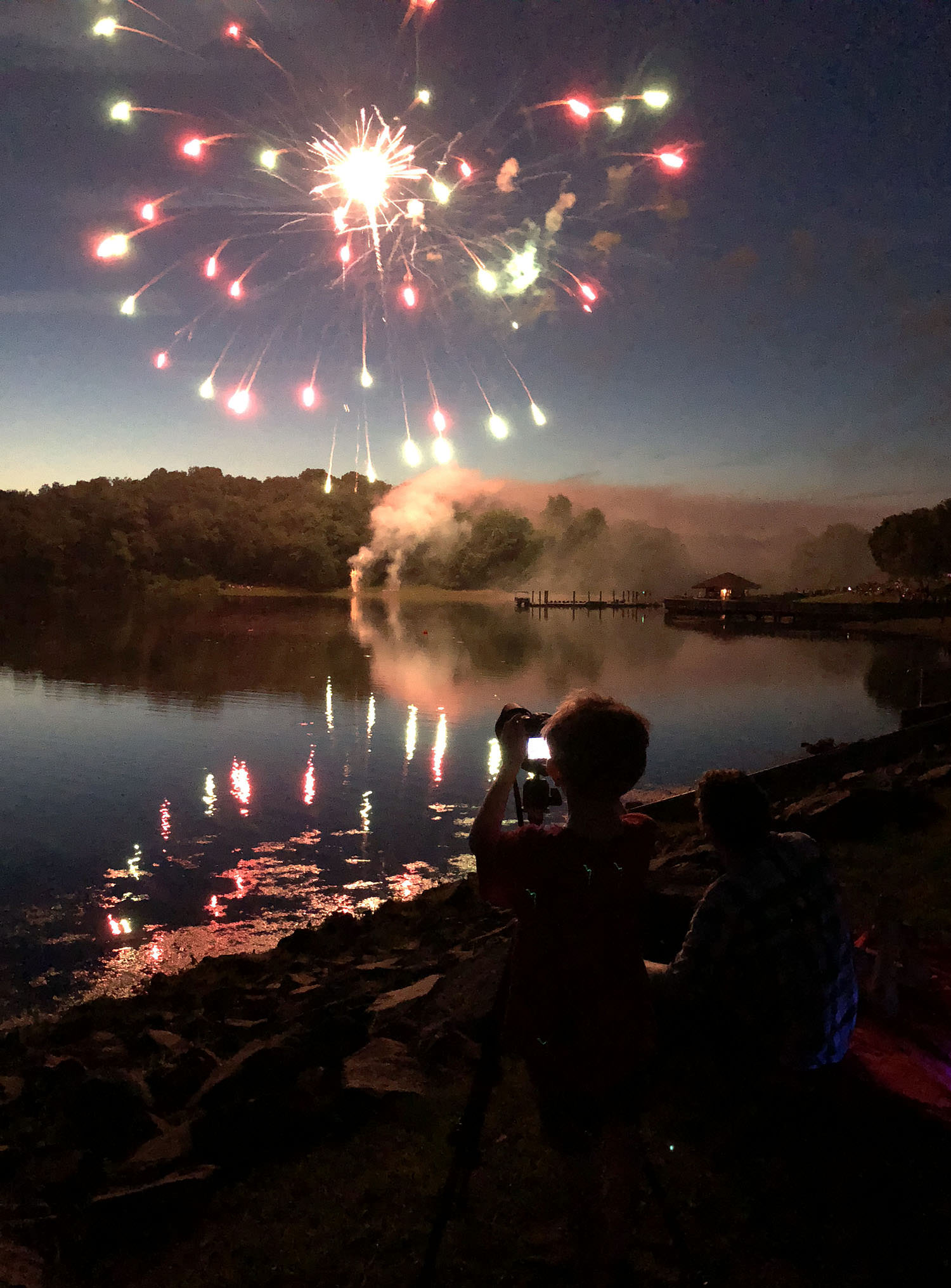 Child with tripod and fireworks