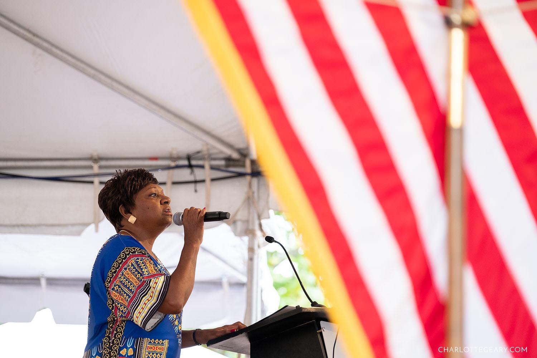 Leila Gordon, the Executive Director of Reston Community Center, sings the National Athem