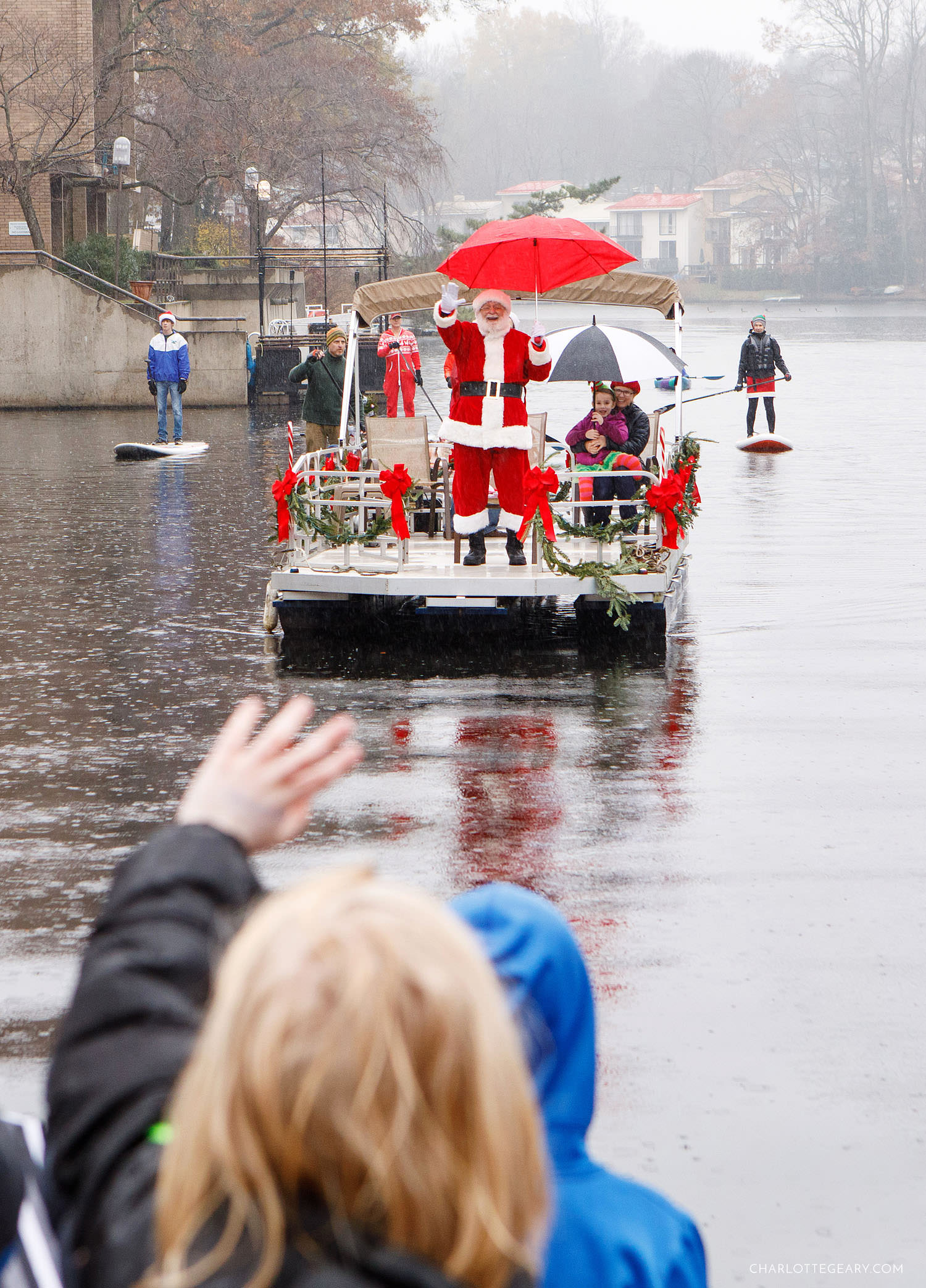 Santa arriving by boat at Lake Anne Plaza (Reston, Virginia)