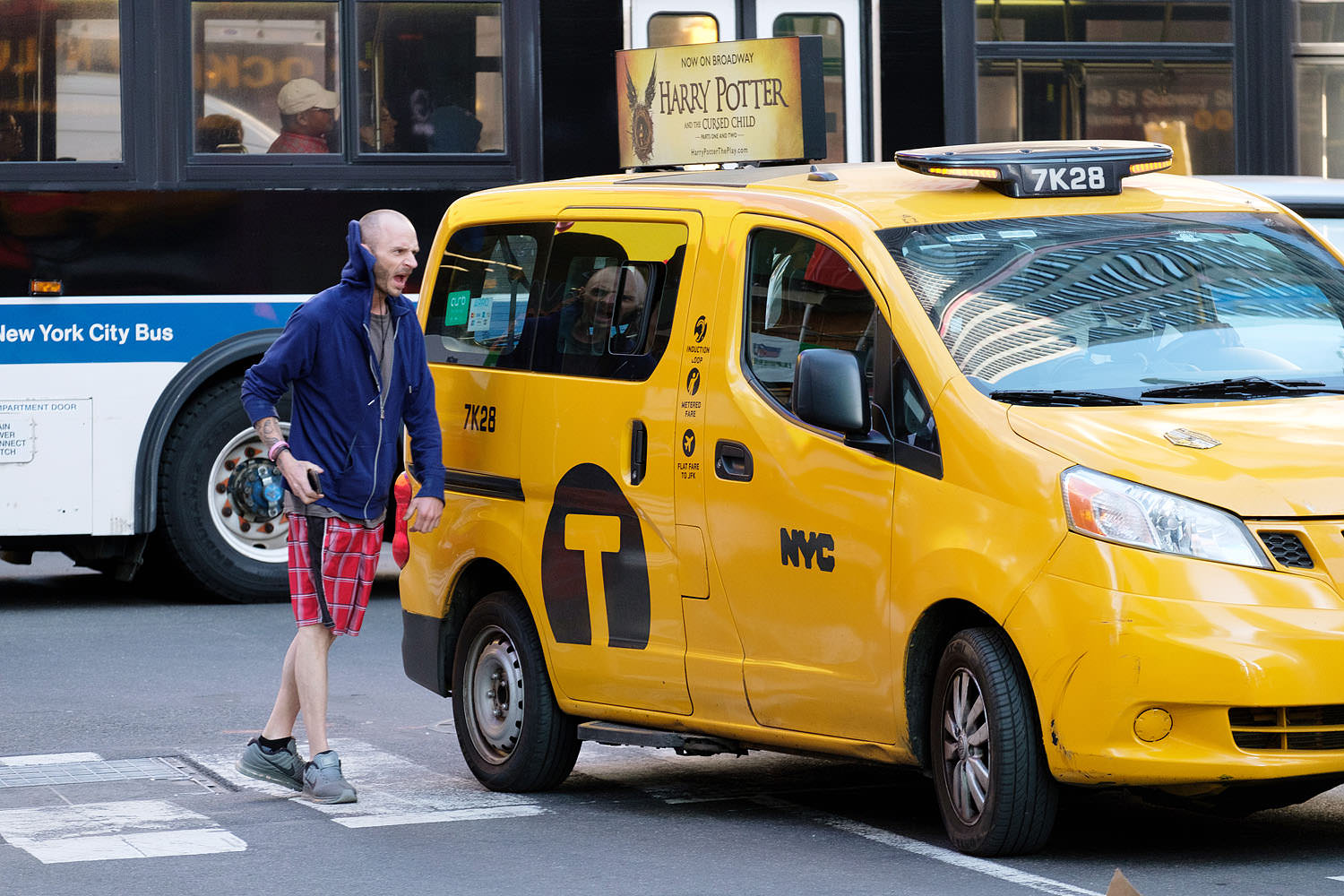 Pedestrian yells at taxi (New York, New York)
