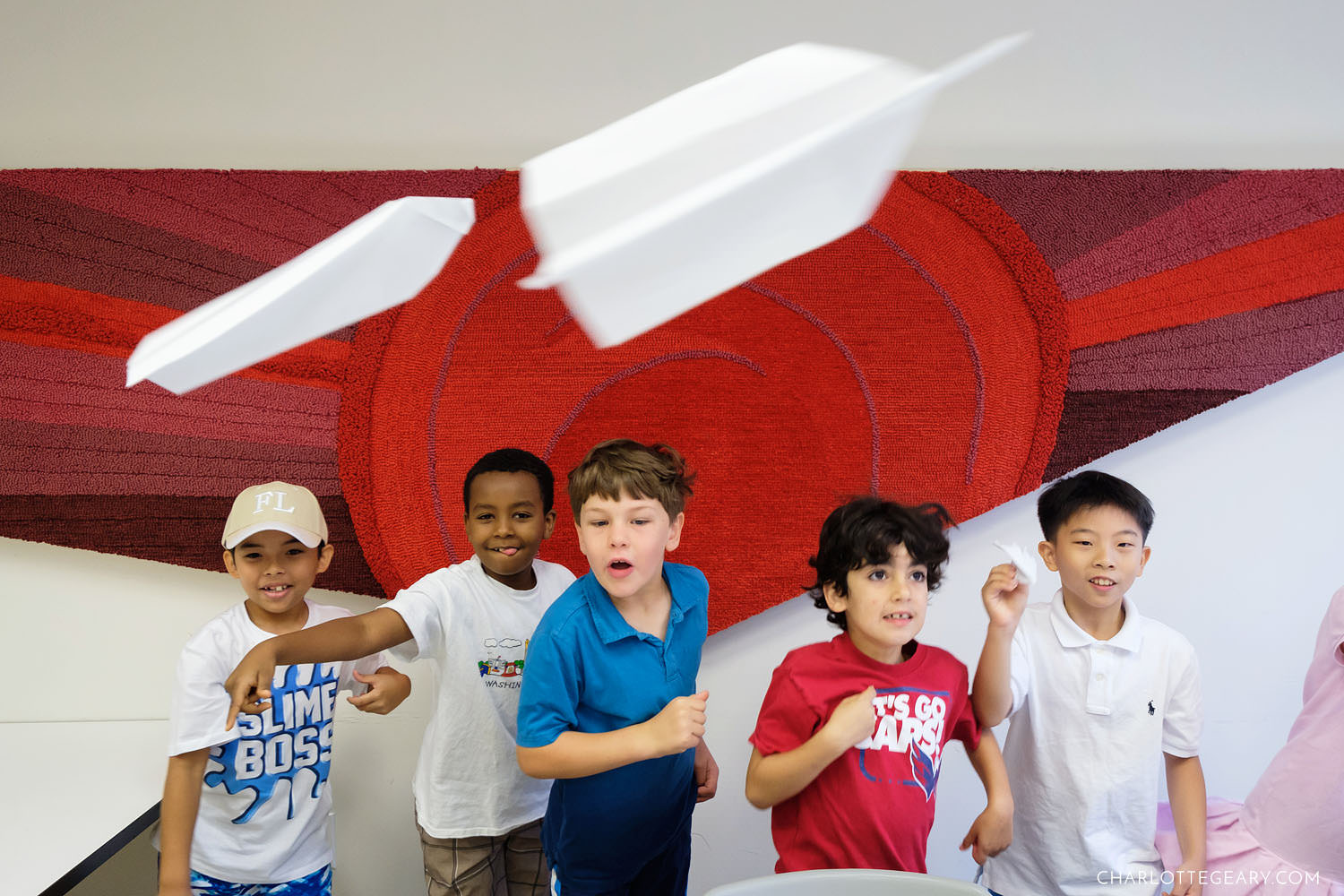 Kids flying paper airplanes at summer camp (Reston, Virginia)