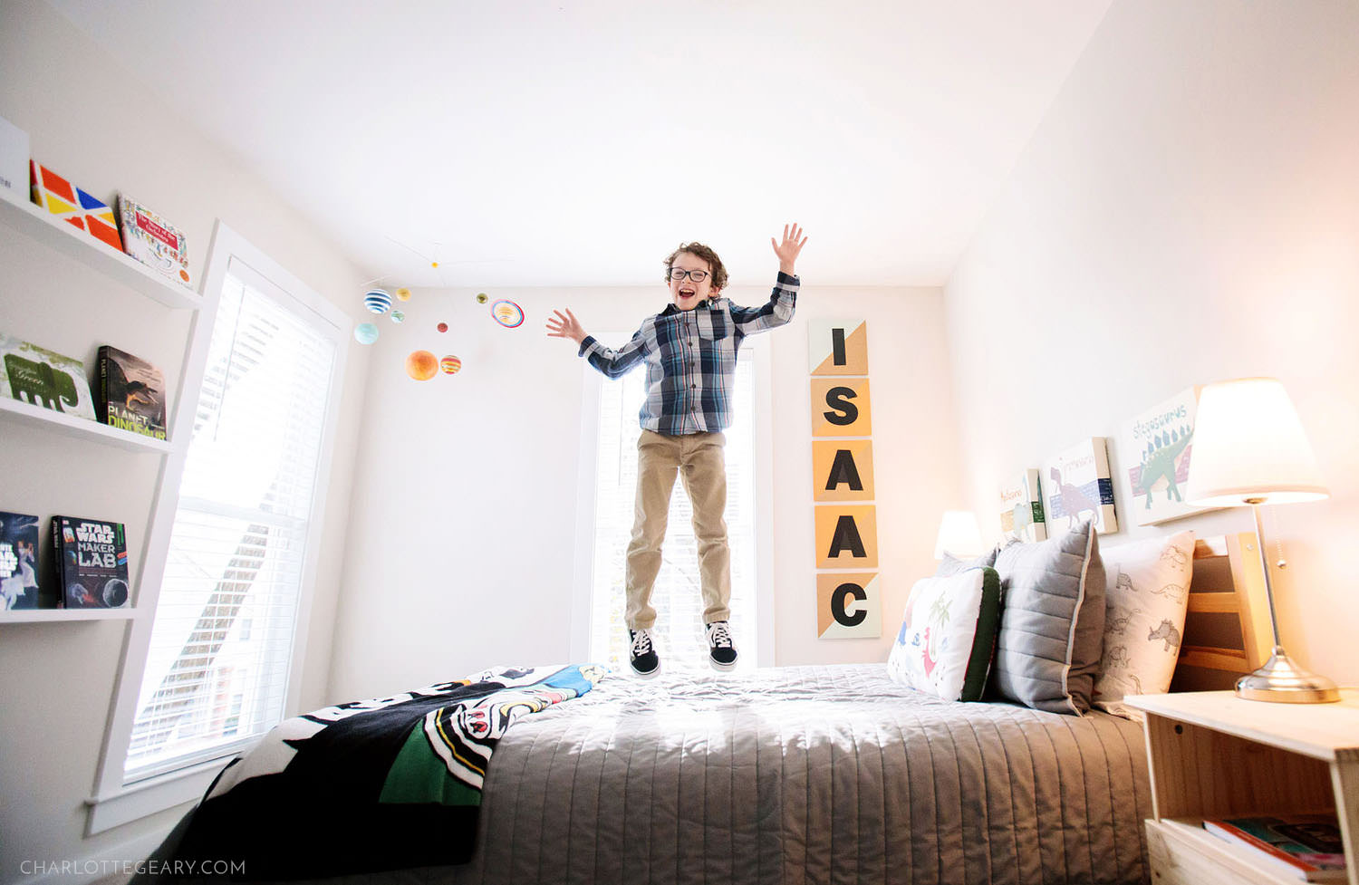 Boy jumping on his bed