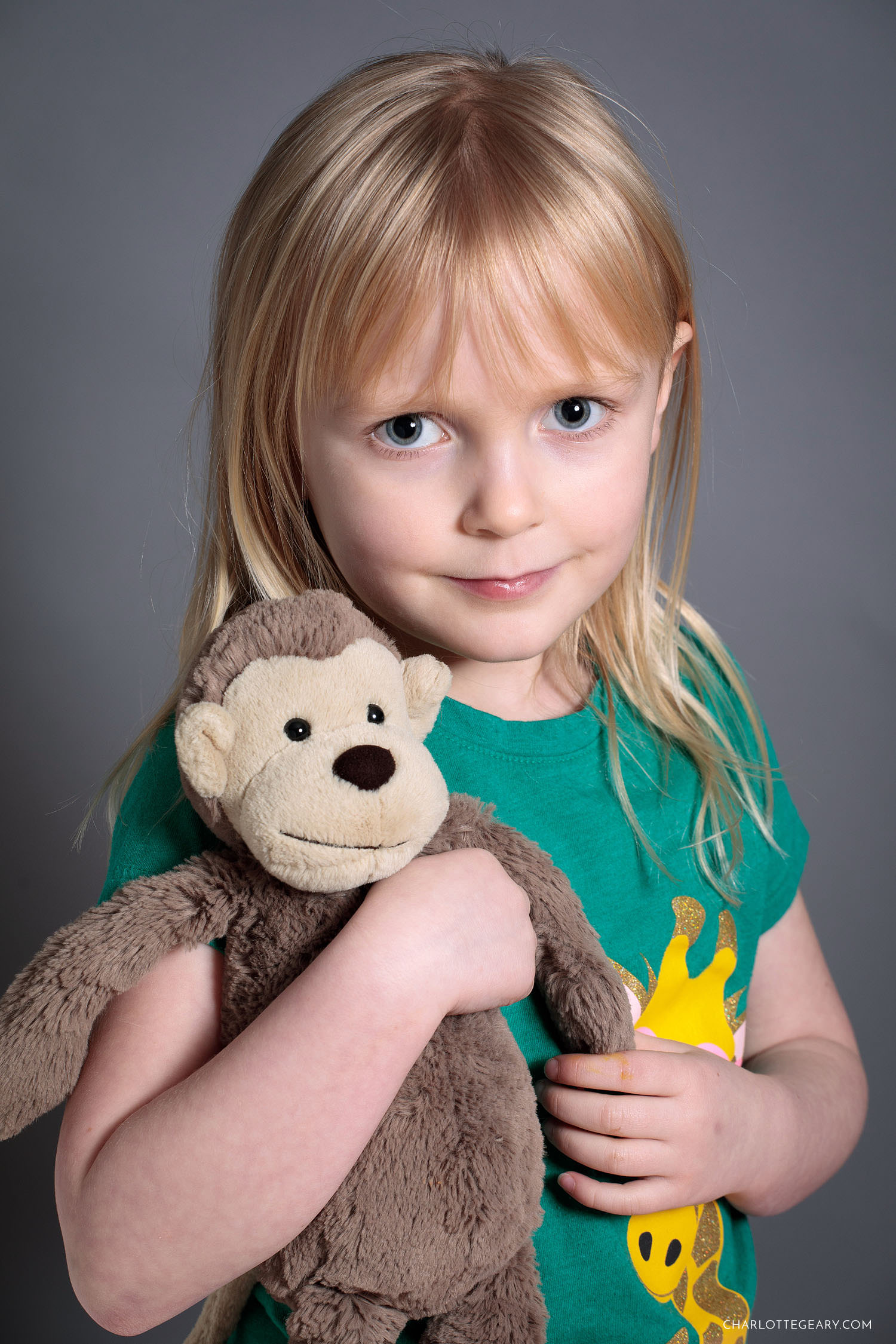 Portrait of a little girl with a stuffed animal