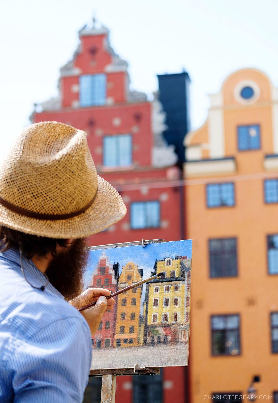 Painter in Stortorget in Stockholm's Gamla Stan
